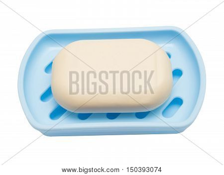 Soap in soap dish isolated on a white background. Flat lay top view