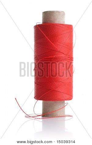 red thread and coil isolated on white