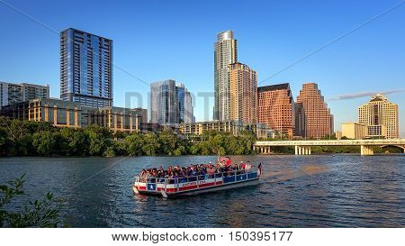 AUSTIN, TEXAS - APRIL 9: Tour boat in front of Austin skyline on the Colorado River in Austin, Texas on April 9th, 2016.