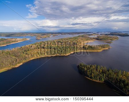 Panorama of lakes and forests of Karelia. Further, one can see meadows and fields. On the sky clouds float. Karelia, Russia. 2016