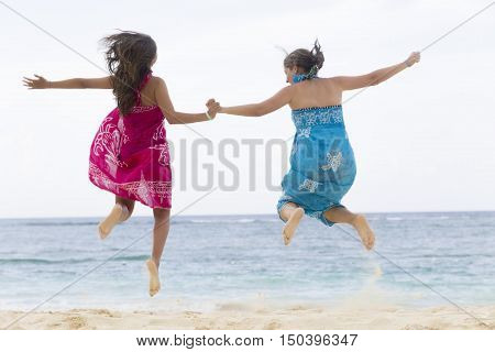 Happiness Mother And Girl Jumping