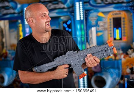 Young Man Playing With A Toy Shotgun