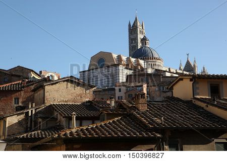 The Cathedral looking out of tiled roofs, Florence, Italy - Many houses, many roofs, many old buildings. Here is the history of the city itself. Under each stone, under each shingle under each building block. All this makes Florence for what it is: an ins