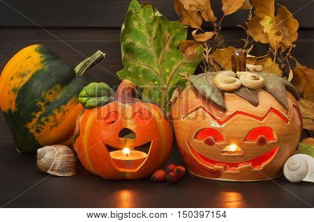 Halloween pumpkin party, Big terrible Pumpkin lighten and reflection on wooden table background. Halloween pumpkin with scary face. Place for your text.