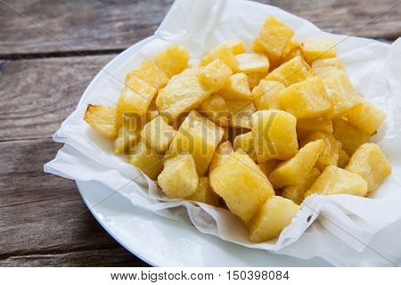 portions of fried potatoes on white paper ready for eat