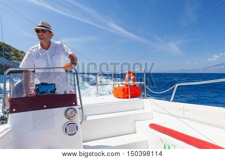 Skipper Of White Fast Pleasure Motor Boat