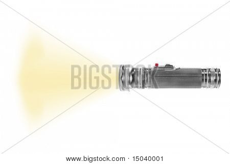 turned on metal flashlight isolated on white