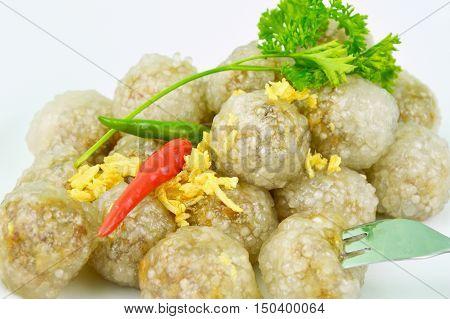 Steamed Tapioca Balls filled with Pork   (thai name is Sakoo Sai Moo) This popular savory appetizer