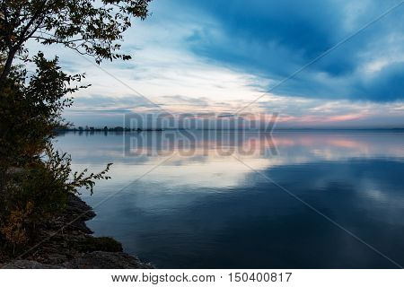 nightfall over the smooth surface of the lake