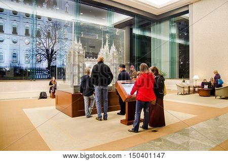 SALT LAKE CITY UTAH USA - JANUARY 31 2015: People in visitors room watching Salt Lake City Temple model