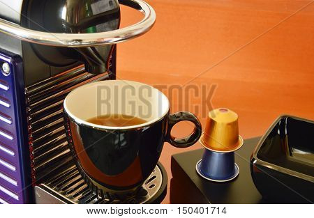 coffee machine with coffee capsules ready to drink