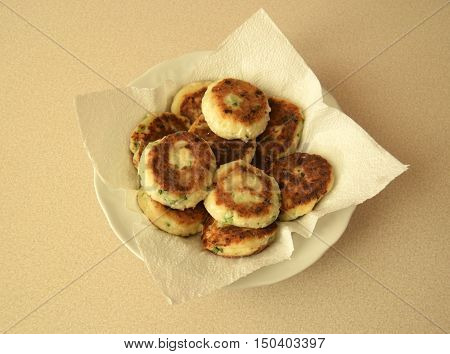 Cheesecakes are a dish of Belarusian cuisine. Cheesecakes it is fried cottage cheese fritters, mixed with flour and eggs