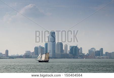 Sailboat On Lower Manhattan Background. New-york. Usa