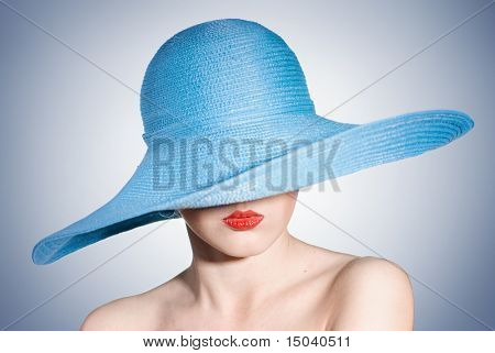 portrait of attractive elegant woman in blue hat