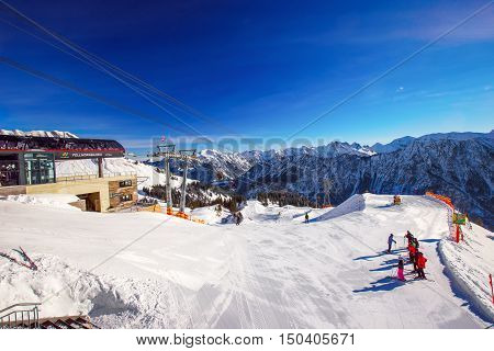 OBERSDORF GERMANY - Ferbruary 23 2015: View to Ski slopes and ski chairlifts on the top of Fellhorn Ski resort Bavarian Alps Oberstdorf Germany