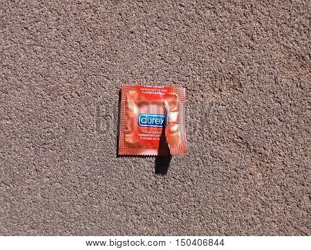 LONDON UK - CIRCA MAY 2016: Durex condom package thrown away on after opening