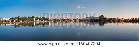 hotels is reflected in the Esperanza lake in Port d'Alcudia. Beautiful reflection of the sky and clouds. Alcudia, Mallorca, Spain.