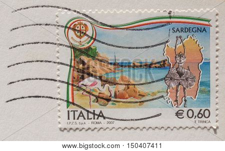 CAGLIARI, SARDINIA, ITALY - CIRCA JANUARY 2014: A stamp printed in Italy reading Sardegna (meaning Sardinia) about Sardinian folk masks with postage meter