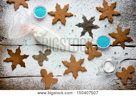 Preparation of Christmas ginger cookies in the form of snowflakes and man top view