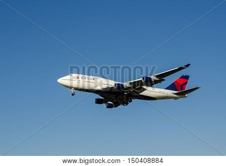 The Delta Air Lines Boeing 747-451 Airplane Arriving To Ben-gurion Airport. Israel