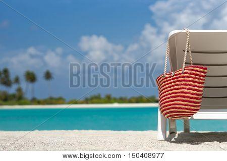 Beach Chairs With Bag On White Sandy Beach