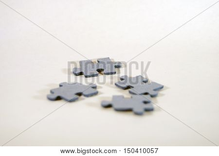 Four pieces of the puzzle upside down on neutral background