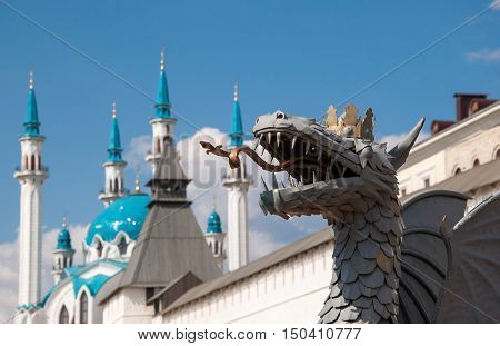 KAZAN, RUSSIA - MAY 3, 2015: Metal sculpture of Zilant on the background of Kazan Kremlin with Qolsharif Mosque. It is a legendary creature, something between a dragon and a wyvern. Kazan, Tatarstan.
