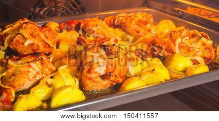 Oven Baked Chicken and Potatoes onion crust, golden, wings, thighs, tasty, appetizing, beneficial, rich in calories, oven 200 degrees recipe food heat