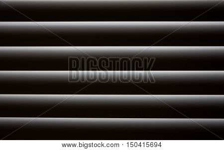 Closed blinds through which light hardly passes. Abstract background blinds