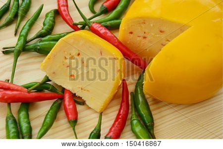chili peppers cheese. fresh chilies with peppers cheese. (soft focus,lens blur)