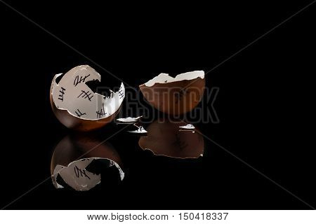 cracked egg shell with countdown on black background monochrome
