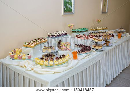 Dessert table for a party. Ombre cake cupcakes. Wedding