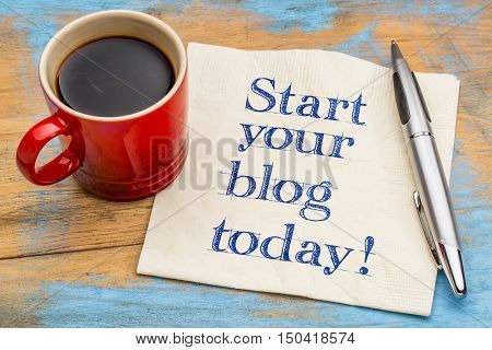 Start your blog today - handwriting on a napkin with a cup of espresso coffee
