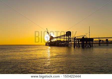Sunset view of the industrial wharf area at the Port of Darwin Darwin Harbour Northern Territory