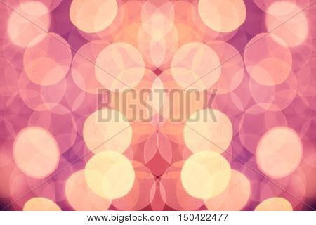 Christmas abstract shiny light bokeh in violet pink colors, vintage retro hipster seasonal holiday background
