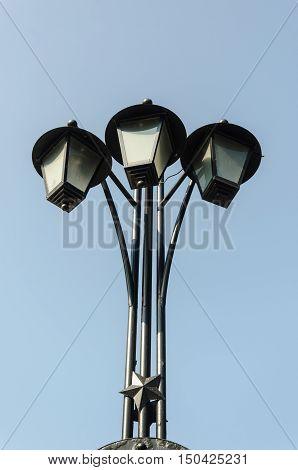Three old electric street lamps in retro style Minsk Belarus