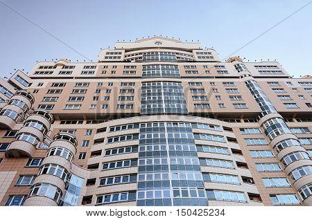 Minsk, Belarus - September 13, 2016: Top of large modern residential building on Storozhevskaya street. View from below.