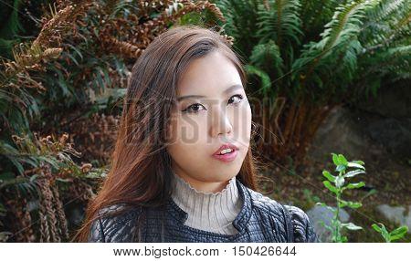 Asian female beauty fashion model expressions outside alone