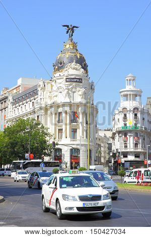 MADRID, SPAIN - September 01, 2016: Road traffic near Metropolis building in Madrid