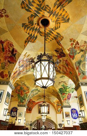 MUNICH, GERMANY - MAY 20, 2016: Ceiling with old wall-painting in Hofbraeuhaus beerhouse in Munich