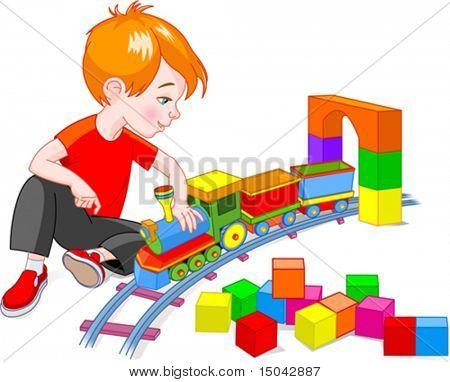 Little boy playing with his wooden train set, isolated on a white background
