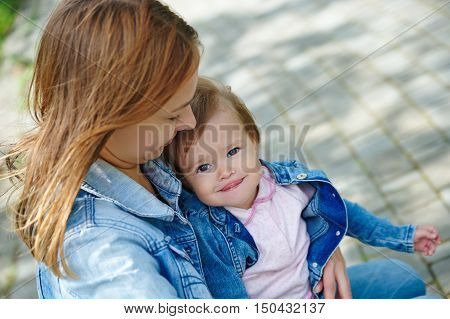 beautiful young mother with a baby summer day outdoors
