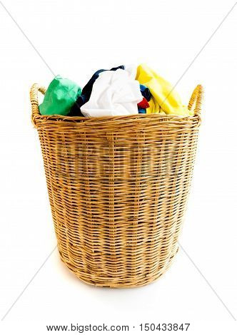 Clothes on wicker baskets for washing preparations whit white background housework concept