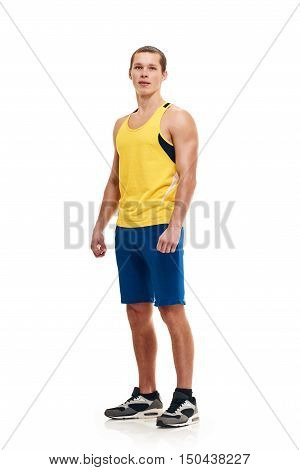 Portrait of a athletic man. full length over a white background