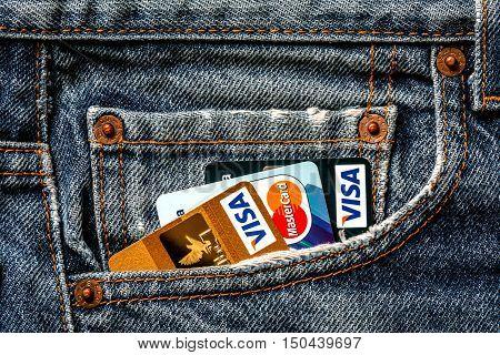 Tallinn, Estonia, September 28.2016. Plastic credit cards VISA  and Mastercard in jeans pocket