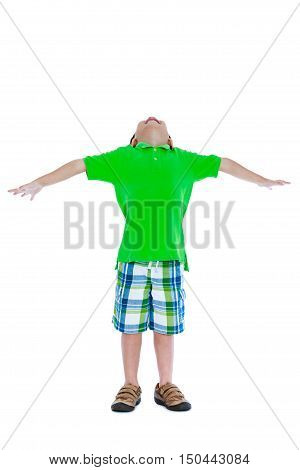 Full body of playful asian child with arms outstretched and look up his head. Isolated on white background. Studio shot.