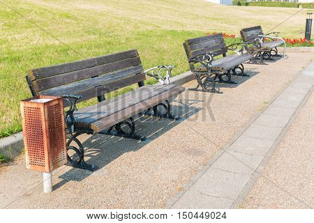 Empty wooden bench in park concept feeling loneliness.