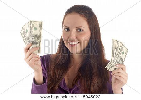 Funny female with two piles of dollars (isolated)