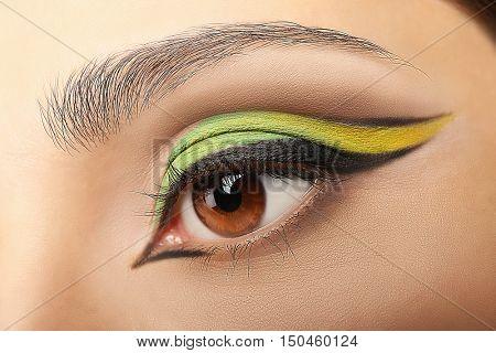 Colourful eye makeup, closeup