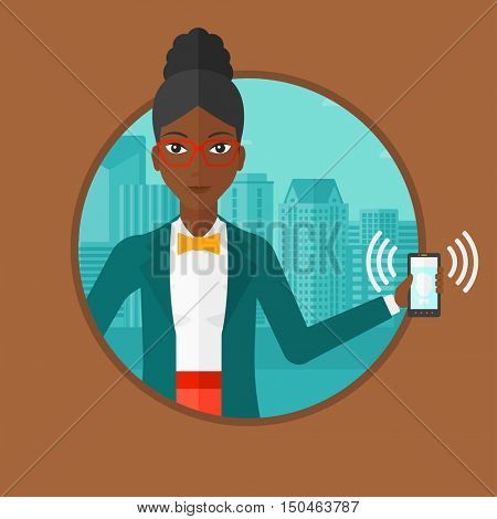 An african-american woman holding ringing mobile phone on a city background. Young smiling woman answering a phone call. Vector flat design illustration in the circle isolated on background.